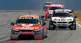 Jamie Whincup in his T8-built Falcon leads James Courtney in his T8-built Jim Beam Racing Falcon