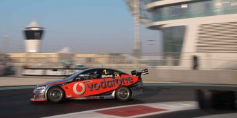 Jamie Whincup pedals his TeamVodafone Commodore around one of the controversial tyre bundles in practice at Yas Marina yesterday