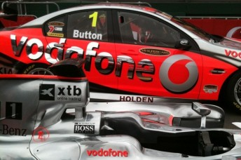 Button's name is on the window of the Commodore, and Whincup's name is on the McLaren ...