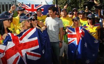 Australian Mark Webber meets The Fanatics before practice for the Australian Formula One Grand Prix at the Albert Park Circuit