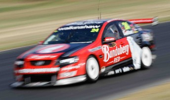 Fabian Coulthard in the 2010-spec Bundaberg Red Racing Commodore VE