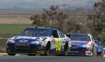 Jimmie Johnson leads Marcos Ambrose at Infineon Raceway