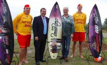 Surf Lifesavers Ashley (far left) and Bernard (far right) were on hand to help the Minister Phil Reeves and Tony Cochrane unveil the band that is all about sun, sand and surf