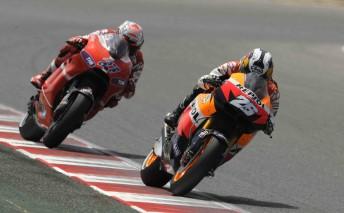 Honda's Dani Pedrosa leads Ducati's Casey Stoner