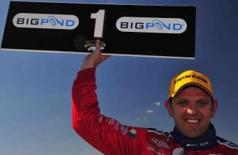 Jason Bright celebrates after winning Race 8