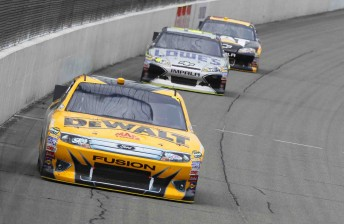 Marcos Ambrose leads Jimmie Johnson
