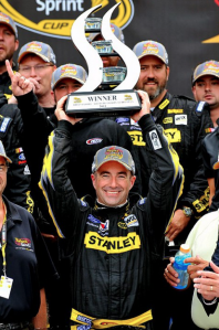 Marcos Ambrose celebrates his maiden NASCAR win with his team-mates