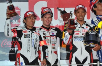 The Yoshimura Suzuki riders on the podium