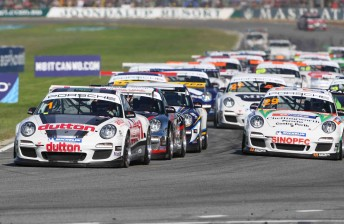 The Carrera Cup field rushes into turn one at Barbagallo Raceway