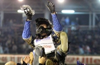 Greg Hancock gets the traditional 'three bumps' after his SGP Championship win
