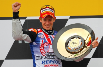 Casey Stoner celebrates his world title win