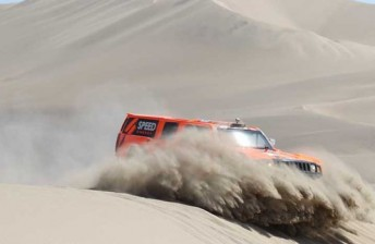 Robby Gordon rolled on Stage 13