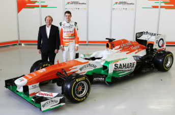 Force India's Chief Operating Officer Otmar Szafnauer with driver Paul di Resta