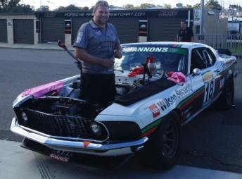 Mechanic 'Big Sammy' haflway through the engine change on Bowe's Mustang