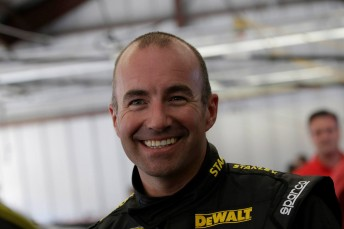 Smiles for  Marcos Ambrose despite an engine glitch