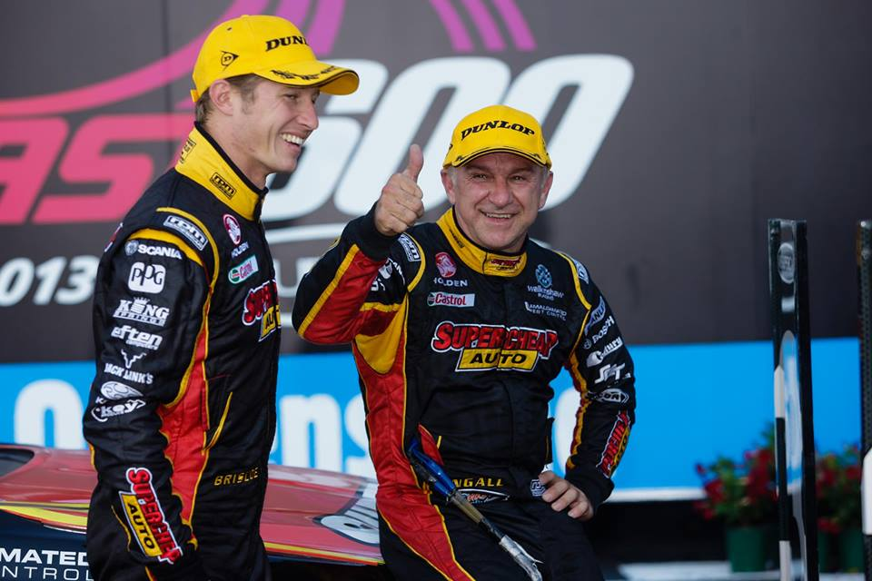 Russell Ingall celebrates third place in Race 31 with Ryan Briscoe