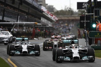 Lewis Hamilton leads Mercedes team-mate Nico Rosberg out of the pitlane in Melbourne