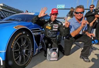 James Davison celebrates GTD pole with team owner Kevin Buckler