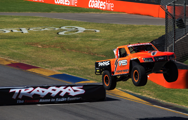 Robby Gordon attacking the first jump on pit straight