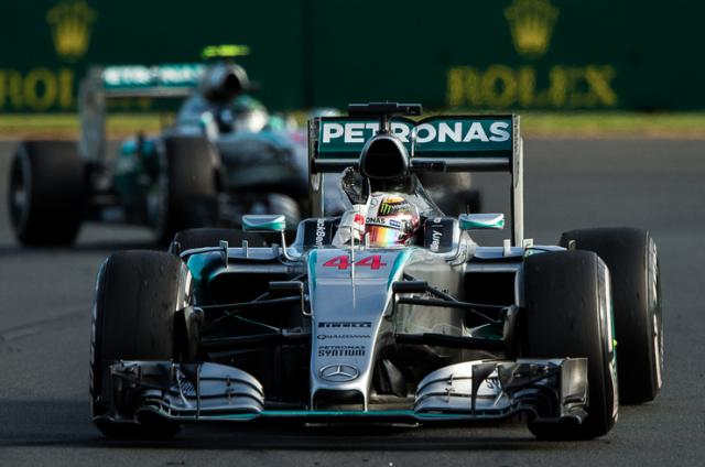 Hamilton celebrates ahead of team-mate Rosberg