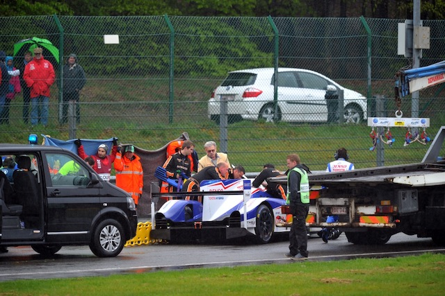 Officials come to the aid of Nakajima after he slammed into the back of the #8 Audi at Spa