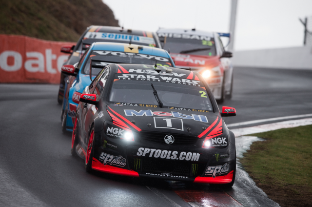 The Tander/Luff Commodore cutting through the mid-race gloom