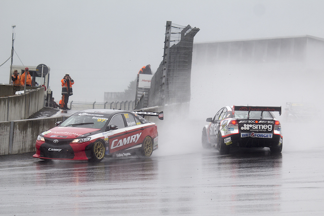 Jason Bargwanna slips up the inside of a spinning Simon Evans at Hampton Downs. pic: Matt Smith