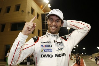 Mark Webber celebrates winning the title after a challenging race in Bahrain