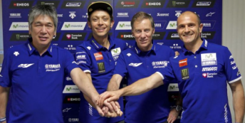 Valentino Rossi celebrates new Yamaha contract