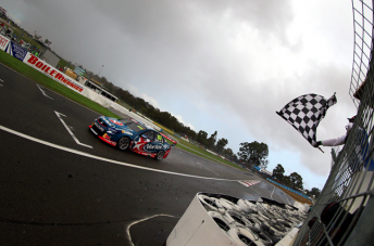 Craig Lowndes takes the flag in Race 8 at Barbagallo Raceway