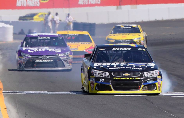 Stewart beats Hamlin to the line after their collision