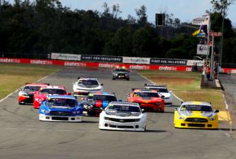 The TA2 Racing Australia field heads to Turn 1 at Queensland Raceway