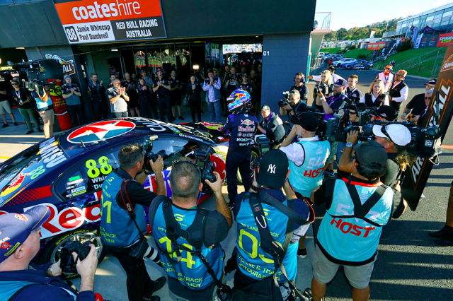 Photographers swarm around pole sitter Whincup