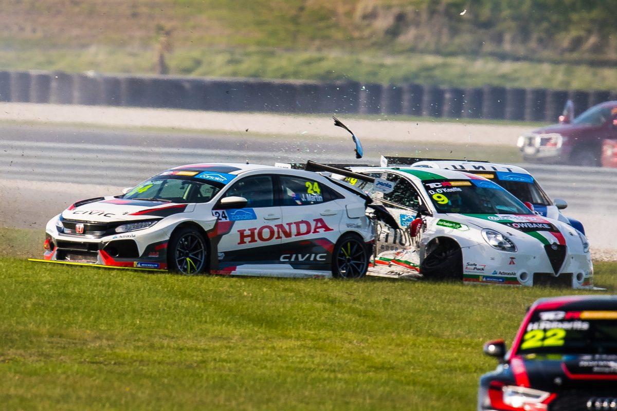Wall Racing assessing damaged Martin Honda - Speedcafe