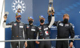 Matt Campbell on the podium at Le Mans for Porsche customer team